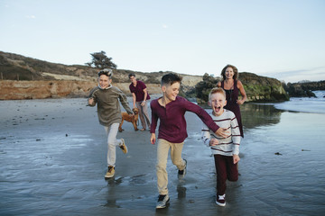 Happy family enjoying beach
