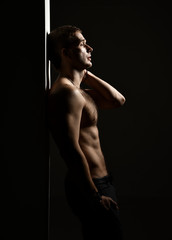 Closeup portrait of sexy handsome topless male model