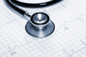 Stethoscope in shape of heart beat on electrocardiogram.