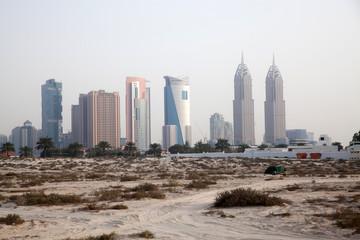 DUBAI, UAE - FEBRUARY 2018: A view of Dubai skyscrapers  from black palace public beach.