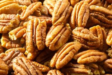 Pecans nuts. A close-up photograph. Unrefined whole kernel