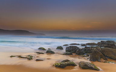 Hazy and Rocky Dawn Seascape