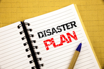 Disaster Plan. Business concept for Emergency Recovery written on notepad with copy space on old wood wooden background with pen marker