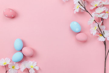 Top view aerial image of decoration & symbol Happy Easter holiday background concept.Flat lay accessory bunny eggs & floral on modern beautiful pink paper at home office desk.Free space for design.
