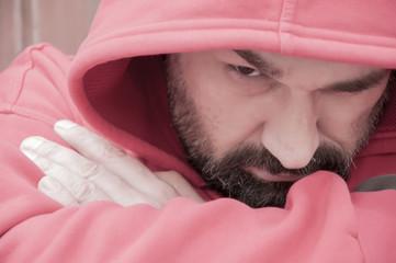 man portrait in hooded sweatshirt