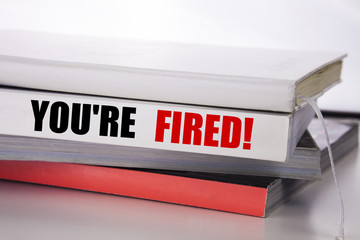 Writing text showing You Are Fired. Business concept for Unemployed or Discharge written on the book on the white background.