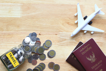 Saving planning for Travel budget of holiday concept,Financial,Stack of coins money in the glass bottle and airplane with passport