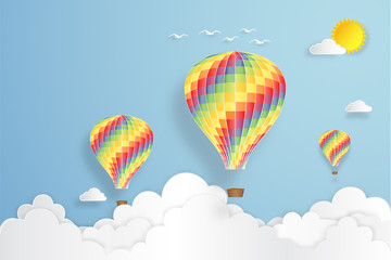 Colorful hot air balloon flying under blue sky and sunny as paper art, craft style concept. vector illustration.