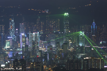 Fototapete - Hong Kong skyline at night with laser light show