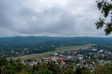 Runway of Airport in Countryside with village and lake in the hill in the cloudy day with soft sunlight, Traveling in Thailand