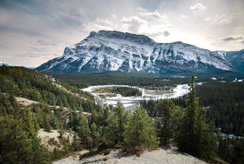 Mt Rundle stands proud beyond the Hoodoos of Banff, Alberta