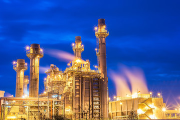 Oil and gas industry,refinery factory,petrochemical plant area at Sunrise with cloudy sky.
