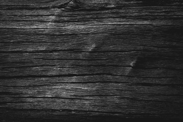 Black wooden texture background.