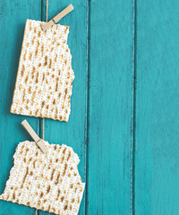 Two pieces of matzah or matza on a vintage wood background with copy space or text space. Perfect for your Passover design