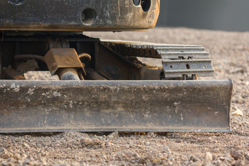 Bulldozer (Continuous Tracked Tractor) parking on soil at construction site