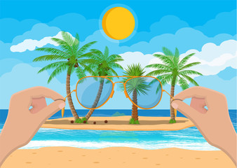 Landscape of beach, hand with sunglasses.