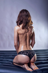 Sexy young woman in panties view from back.