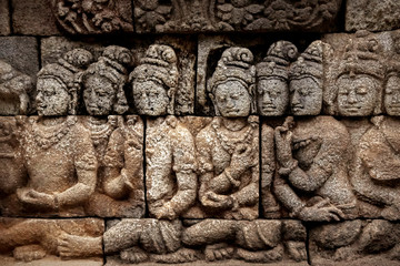 Ancient bas-reliefs on the walls of the Borobudur temple. Indonesia. Java is an island.