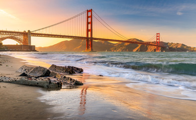 Sunset at the beach by the Golden Gate Bridge in San Francisco California Wall mural