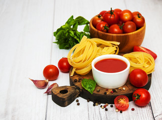Bowl with tomato sauce