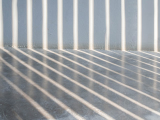 The sun light casting over the white concrete wall,sunshade shadow