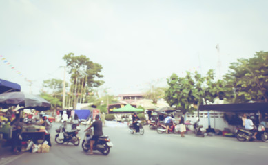 Vintage tone blurred defocused people on thailand street market abstract background