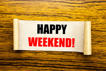 Hand writing text caption inspiration showing Heppy Weekend . Business concept for Weekend Message written on sticky note paper on the wooden background.