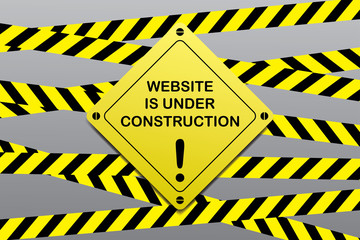 Website is under construction,yellow black ribbons and warning sign