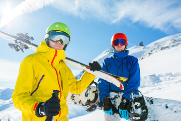Picture of sports men with skis and snowboard in winter