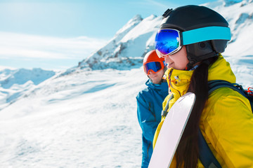 Picture of athlete with helmet, snowboard and men