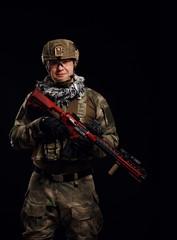 Image of soldier in helmet with gun