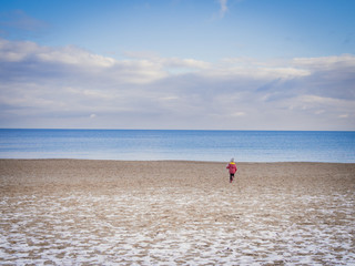 Child on the baltic seaside in winter