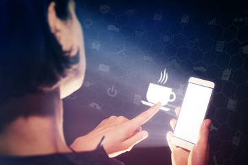 Image of a woman with a smartphone in her hand. She touch the icon cup with hot drink. She lookin a menu, chooses hot drinks, orderin food delivery using online services.