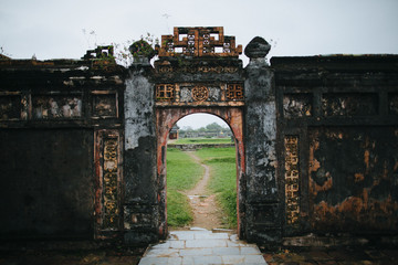 ruins of ancient gates with oriental symbols in Hue, Vietnam