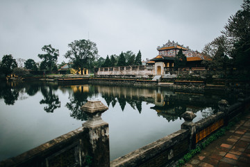 beautiful calm pond and ancient oriental architecture in Hue, Vietnam