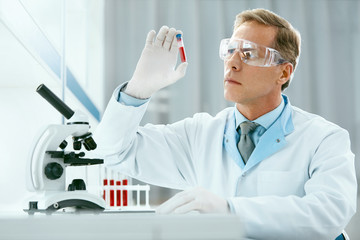 Laboratory Test. Male Doctor Analyzing Blood Sample