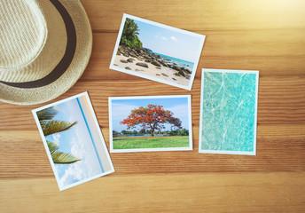 Top view photo album on wood.
