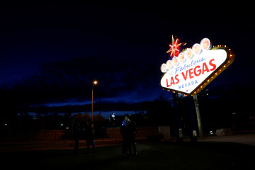 Tourists take pictures in front of the iconic 'Welcome to Fabulous Las Vegas' sign on Las Vegas Boulevard in Las Vegas