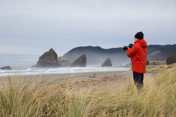 Photographer taking picture in the beautiful Oregon Coast during a winter morning.