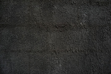 Fur coat of cement with sand of dark gray color solid concrete