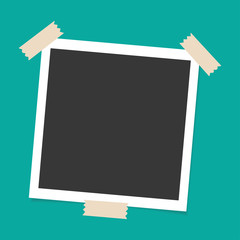 Photo frame with sticky tape on green background. Template, blank for your trendy photo