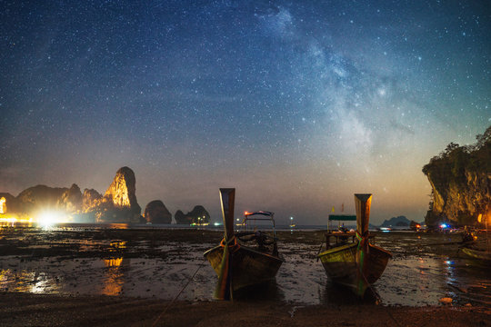 Small boats on sandy shore at night