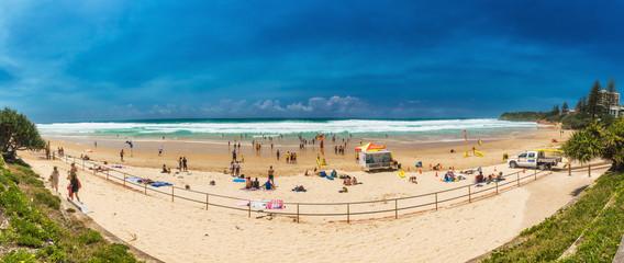 COOLUM, AUSTRALIA, FEB 18 2018: People enjoying summer at Coolum main beach - a famous tourist destination, Queensland, Australia.