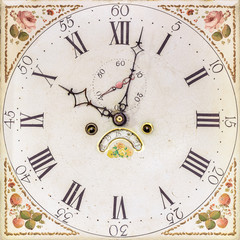 Clock with hand painted floral decoration