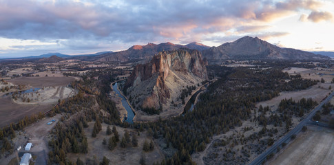 Aerial panoramic view of a beautiful landmark, Smith Rock, famous for rockclimbing. Taken in Redmond, Oregon, America, during a vibrant sunrise.