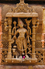 Carved idol on the outer wall, Hatkeshwar Mahadev, 17th century temple, the family deity of Nagar Brahmins. Vadnagar, Gujarat