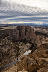 Striking landscape of the famous location, Smith Rock, during a winter cloudy evening. Taken in Oregon, United States of America.