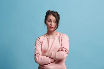 Beautiful bored woman bored isolated on blue background