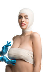 Gorgeous woman examined by plastic surgeon