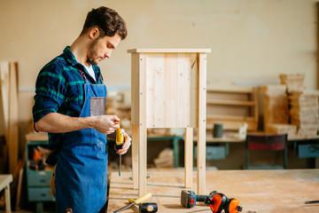 master carpenter working in his woodwork or workshop